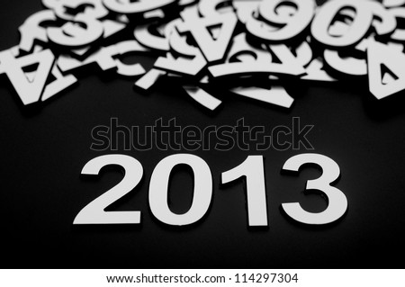 digit 2013 and many random numbers on black background - stock photo
