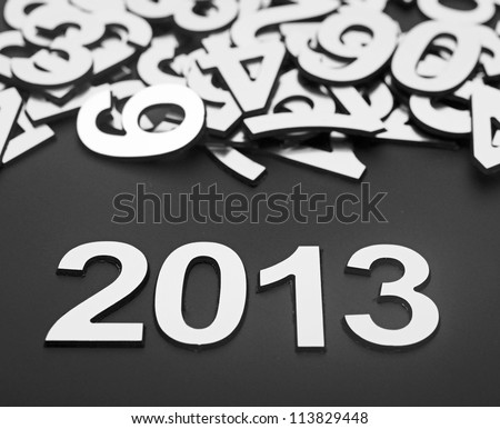 digit 2013 and pile random numbers on black background - stock photo