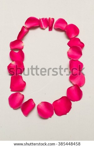 digit arranged by Red rose petals, white background isolated, number 0