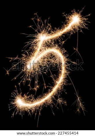 Digit five made of sparklers - stock photo