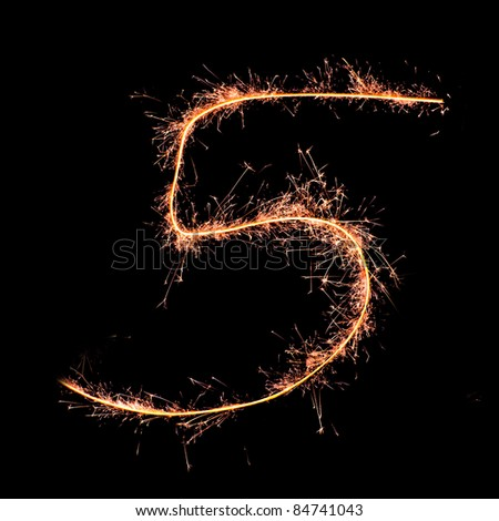 Digit 5 made of sparklers isolated on black - stock photo