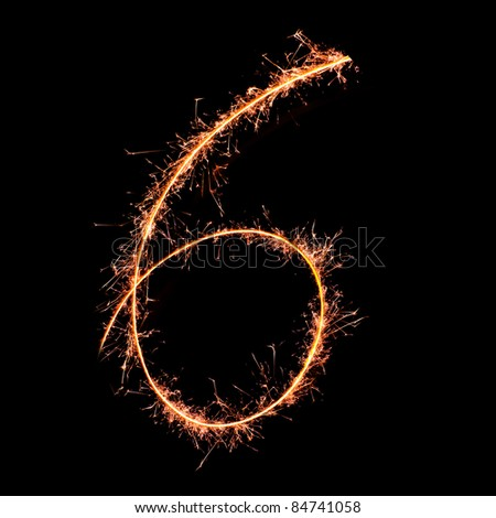 Digit 6 made of sparklers isolated on black - stock photo