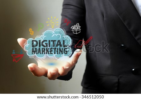 digitak marketing concept with icons on hand , business concept , business idea - stock photo