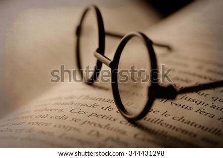 Digital art, glasses on open book (french words) grunge texture                                - stock photo