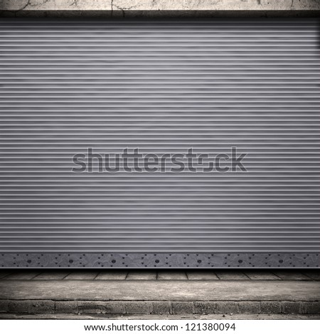 Digital background for studio photographers. Painted corrugated metal door with conrete wall and ground. - stock photo