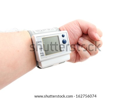 Digital blood pressure monitor on the wrist isolated on white
