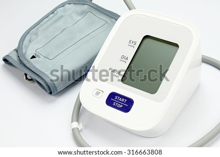 Digital Blood Pressure Monitor on white background, Medical equipment, Examining equipment. - stock photo