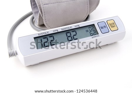 Digital blood pressure monitor with cuff - stock photo