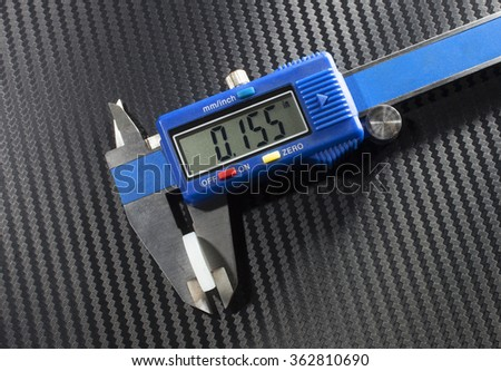Digital caliper that is measuring the wad in a shotshell - stock photo