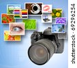 Digital camera and photographs against blue background and world map - stock photo