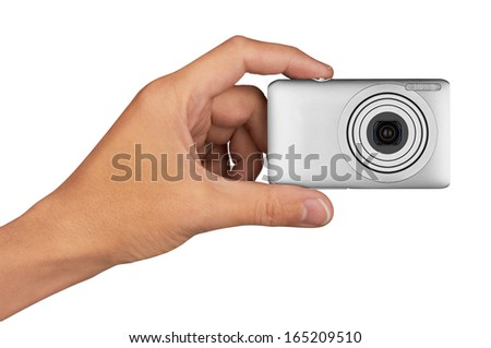 Digital camera in hand, isolated on white background - stock photo