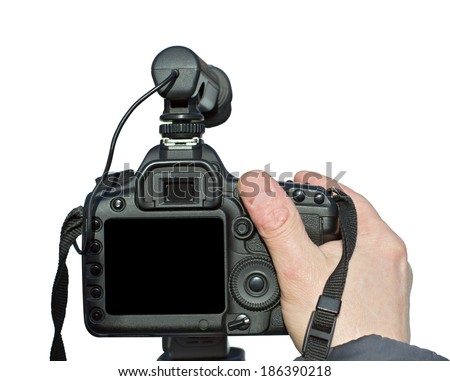 Digital camera in hand on a white background - stock photo