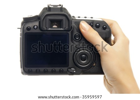 Digital camera in woman hand. - stock photo