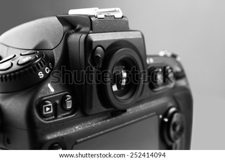 Digital camera on gray background - stock photo