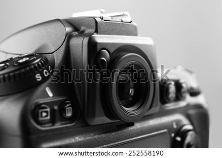 Digital camera on gray background - stock photo
