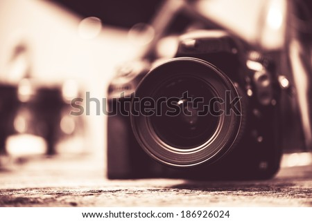 Digital Camera with Wide Angle Lens Vintage Browny Color Grading. - stock photo