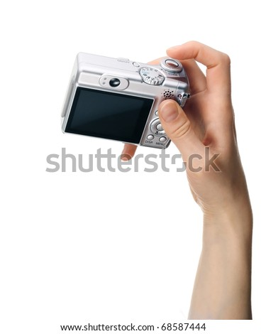 Digital compact camera in hand isolated