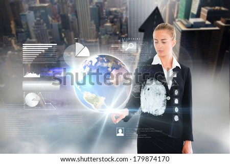 Digital composite of blonde businesswoman touching earth interface, elements of this image furnished by NASA - stock photo
