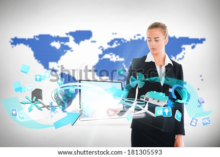 Digital composite of blonde businesswoman touching laptop with app icons