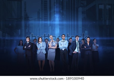 Digital composite of business team against cityscape background - stock photo