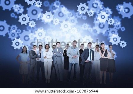 Digital composite of business team against cogs and wheels background