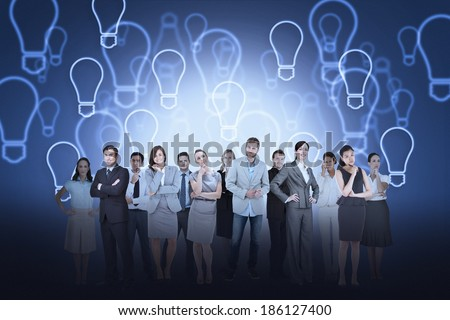 Digital composite of business team against light bulb background - stock photo