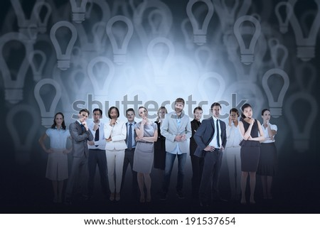 Digital composite of business team against light bulb background