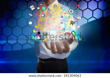 Digital composite of businessman presenting app icons
