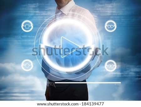 Digital composite of businessman presenting music player interface
