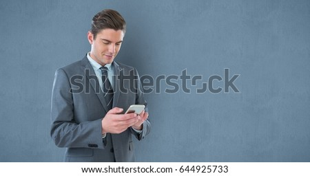 Digital composite of Businessman texting on smart phone against wall