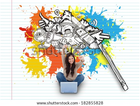 Digital composite of cheering girl using laptop with doodles - stock photo