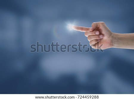 Digital composite of Hand touching the air with glow
