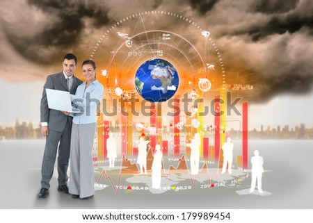 Digital composite of happy business team using laptop with map and human representations, elements of this image furnished by NASA