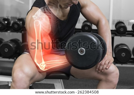 Digital composite of Highlighted arm of strong man lifting weights - stock photo