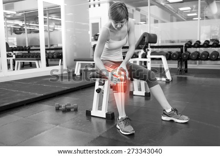 Digital composite of Highlighted bones of injured woman at gym - stock photo