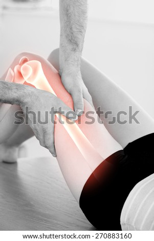 Digital composite of Highlighted bones of woman at physiotherapist - stock photo
