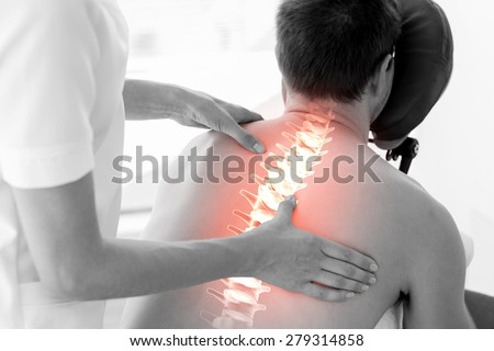 Digital composite of Highlighted spine of man at physiotherapy - stock photo