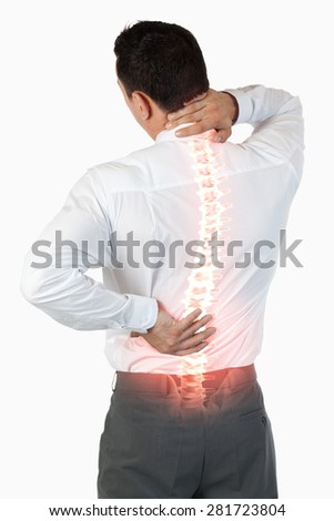 Digital composite of Highlighted spine of man with back pain - stock photo