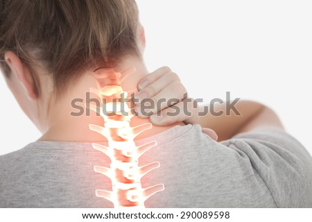 Digital composite of Highlighted spine of woman with neck pain - stock photo