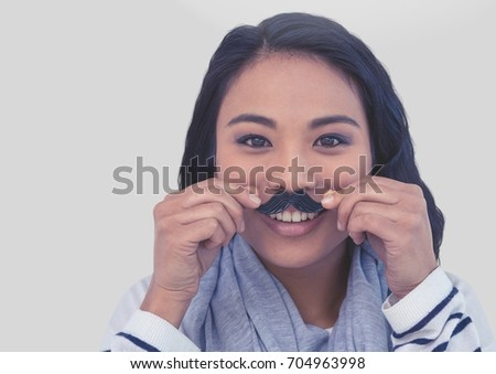 Digital composite of Portrait of woman wearing mustache with grey background