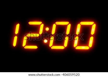 Digital display showing twelve o'clock - stock photo