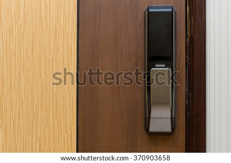 Digital door lock on wooden door