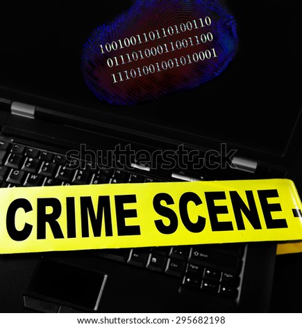 digital fingerprint on a laptop with crime scene tape  - stock photo