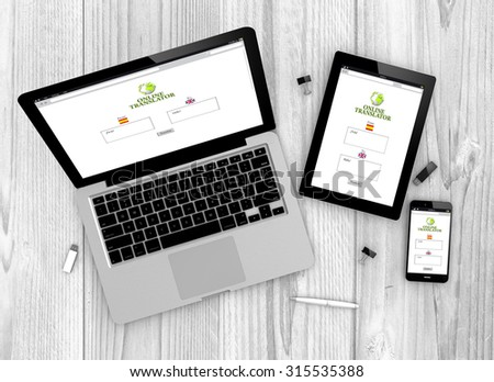 Digital generated devices over a wooden table. laptop, tablet and white smartphone with made up translation interface. - stock photo