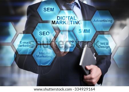 Digital marketing concept. Businessman selecting and pressing digital marketing icon. - stock photo