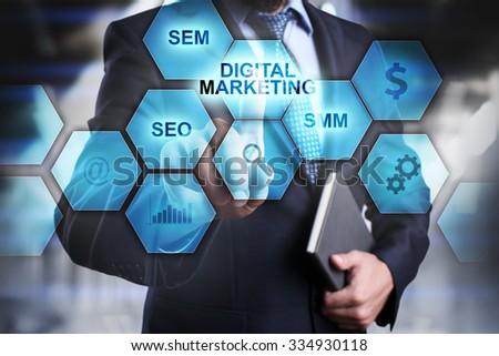digital marketing concept man selecting and pressing digital marketing icon. - stock photo