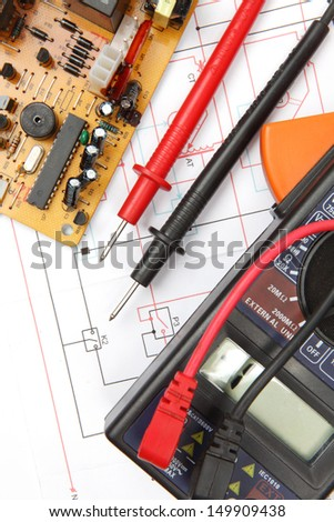 Digital multimeter and electronic components - stock photo