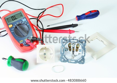 digital multimeter or multitester or Volt-Ohm meter, an electronic measuring instrument that combines several measurement functions in one unit. power socket. Screwdriver Tool