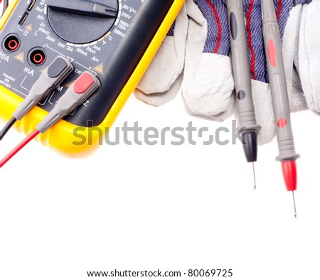 Digital multimeter, probes and gloves isolated on white - stock photo