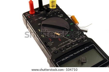 Digital multimeter with electrical components. - stock photo